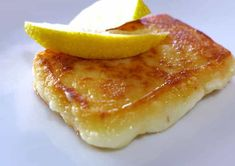 Pan-seared Greek cheese appetizer (Saganaki) - Pan-seared cheese forming a nice golden crust and bubbly inside. Find this and other Christmas rec - Greek Fried Cheese, Baked Cheese, Cheese Fries, Saganaki Cheese Recipe, Greek Appetizers, Cheese Appetizers, Appetizer Recipes, Dinner Recipes, Kitchens