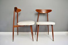 Pair of Mid-Century Wood and Metal Dining Chairs by thewhitepepper
