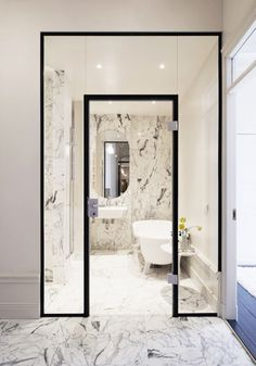 This spa bathroom with walk-in shower, designed by Jordens ARchitecture, is sure to inspire your next bathroom remodel or renovation, via @sarahsarna.