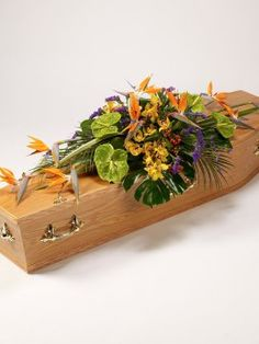 Exotic Casket Spray including Strelitzias, Anthuriums and Cymbidium Orchids, Monstera leaves and Hypericum berries, available fom www.sussexfunerals.com. £195 Casket Flowers, Funeral Flowers, Funeral Caskets, Casket Sprays, Funeral Tributes, Sympathy Flowers, Cymbidium Orchids, Flowers Online, Flower Delivery