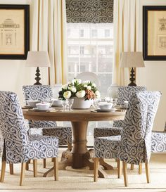 LOVE the material on the chairs plus round table...plus shade and curtains!!!!.
