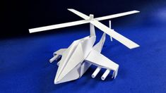 How to make a helicopter from paper with your own hands. Origami Helicopter, Origami Airplane, Instruções Origami, Oragami, Celtic Sword Tattoo, Diy Bracelets Video, Black Panther Drawing, Home Crafts, Diy Crafts