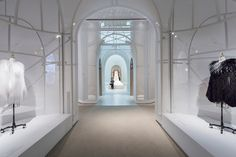 """In the exhibition's central, cathedral-like """"cocoon"""" several open volumes of Denis Diderot and Jean le Rond d'Alembert's Encyclopédie — the text that first defined the métiers — encircle the Chanel gown and act as a navigational aid, leading visitors to different segments of the outer chambers, seen here. © OMA, Photo by Brett Beyer"""