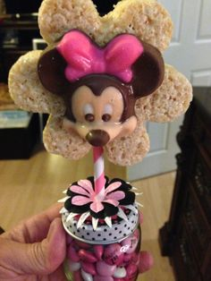 Minnie Mouse favor with chocolate and Rice Krispy treat.  Favor is baby food jar filled with M&M's.