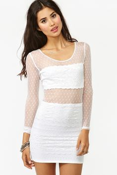 Bodycon lace dress with mesh detailing and polka dot print. Daw'some.