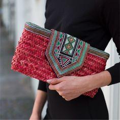 The Red Sleysla Clutch, handcrafted in Saudi Arabia by the women working at the Sleysla Centre in Jeddah. Handmade Fabric Bags, Handmade Clutch, Sacs Design, Diy Wallet, Backpack Pattern, Straw Handbags, Art Bag, Jute Bags, Crochet Handbags