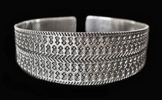 BTJB1 - Viking Bracelet from Jutland - silver Dimensions 65mm x 55mm x 24mm, but can easily be opened up or gripped together to fit, thickness 1mm.   Weight 45g   A bracelet size replica of the original armring from the Hørdum hoard, Jutland, Denmark, c.800-900  See Viking armrings for the original armring version   Silver £135, US$191.21, €170.35
