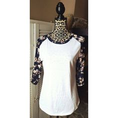 Floral sleeve baseball style t-shirt Beautiful navy blue floral sleeves with pink flowers. Baseball style, 3/4 sleeve. Size Large. Cotton blend, lightweight. I suggest a camisole underneath. Bella Edge Boutique  Tops Tees - Short Sleeve