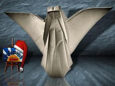 Origami Nativity Angel by Max Hulme Designer: Max Hulme Folder and Photographer: @Origami_Kids How to fold : http://www.origamichristmas.com/2014/11/nativity-origami-angel-max-hulme.htm Difficulty level: Medium Time to fold 45 min. 28 steps. Folded from one classic cream uncut square origami paper, about 25cm x 25cm. Diagram on BOS - Welcome to the 40th anniversary BOS convention - 2007 Pages: 94-97
