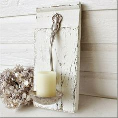 What a unique and beautiful way to present a candle! Ladle attached to a rustic board and a candle sitting in it!