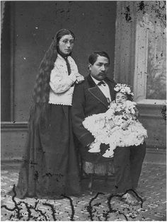 [It was common for family members to pose with their dead loved ones for these photographs.]