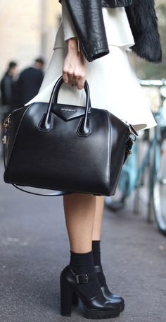 Silvia Garcia is wearing a black and white outfit, a skirt from Zara and the bag is from Givenchy