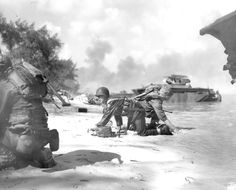 Marines in the first wave during the invasion of Saipan, c.1944