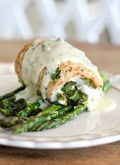 Spinach and Goat Cheese Stuffed Chicken Breasts with Roasted Asparagus: all organic, the cream sauce a little splurge.