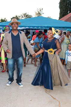 Blue and yellow shweshwe dress by Zodwa Bridals South Africa - Traditional Sesotho Dress worn by Mrs. African Fashion Skirts, African Wear Dresses, South African Fashion, Africa Fashion, African Clothes, African Wedding Attire, African Attire, African Weddings, Traditional Wedding Dresses