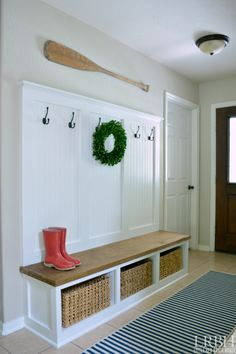 white mudroom cubbies with hooks, love the paneling to set it apart on the wall | 100+ Beautiful Mudrooms and Entryways at Remodelaholic.com