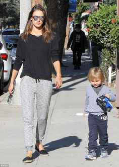 Mommy duty! Alessandra Ambrosio took a break from her globe-trotting modelling career on T...