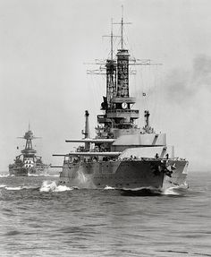 USS Idaho (BB-42) (foreground) and USS Texas (BB-35) steaming at the rear of the battle line, during Battle Fleet practice off the California coast, circa 1930.