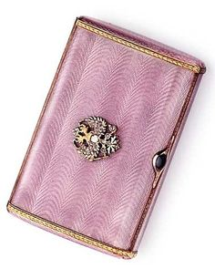 ANTIQUE RUSSIAN JEWELLED GUILLOCHÉ ENAMELLED TWO-COLOUR GOLD-MOUNTED CIGARETTE-CASE MARK OF THE 3RD ARTEL, ST. PETERSBURG, 1908-1917 Oblong, enamelled in translucent mauve over a moiré ground, within foliate borders, the cover further applied with a rose-cut diamond-set Imperial eagle and with a cabochon sapphire thumbpiece.