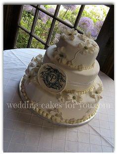 Red velvet wedding cake with gumpaste dogwood flowers @ wedding-cakes-for-you.com