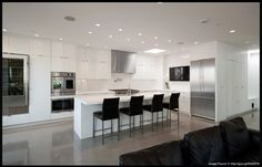 Long kitchen design with glass stacker doors for the third wall
