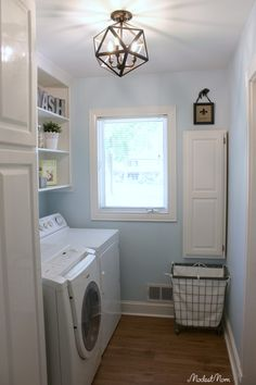 Our laundry room makeover! From wallpaper to paint, and open shelving, this laundry room is now practical and beautiful!