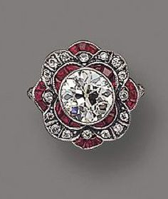 DIAMOND AND RUBY RING- mine & hubby's birthstones