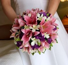 This round lily bouquet requires a lot of pink lilies with white dendrobiums and purple lisianthus.