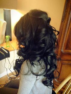 Black messy curls with a poof in the back.