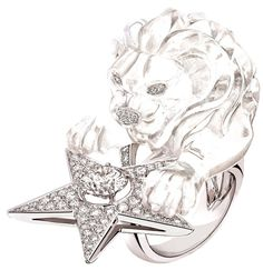 "Chanel ""Constellation du Lion"" ring in 18-karat white gold set with 157 brilliant-cut diamonds for a total weight of 1.9 carat, a 1.5-carat round-cut diamond and a 91-carat fancy-cut (lion-shaped!) crystal.    Via The Jewellery Editor."