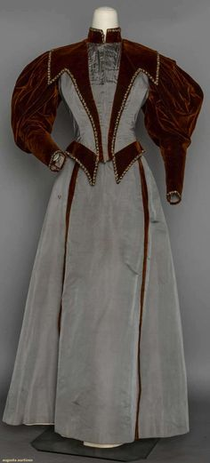 "TWO-TONE AFTERNOON DRESS, c. 1895 2-piece, grey silk twill & rust velvet, trimmed with narrow bands of gold & blue beads, B 36"", W 25"", Skirt L 39"""