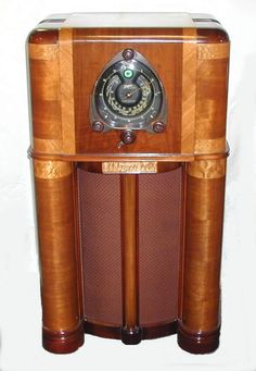 My Mom had one similar to this--not quite as fancy, when I was very little and I remember thinking there was a little man inside of it.
