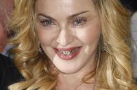 Madonna flaunting her grillz