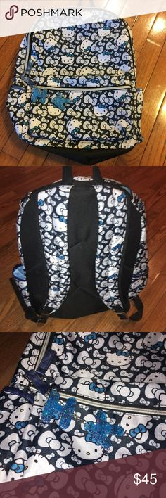 """Hello Kitty Backpack BRAND NEW! Authentic, licensed Sanrio product, without tags. Black, blue and white. No longer sold in stores!! Rare color/print combo. Perfect for kids and even adults! Black w/ White & Blue.  -Measures 16"""" H x 12"""" W x 5"""" D  BUNDLE YOUR LIKES TO SAVE!!! Make me an offer!! Hello Kitty Bags Backpacks"""