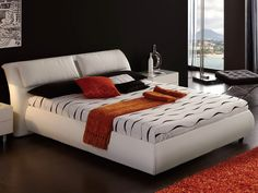 Dupen 615 MEG Bed - This White platform Bed has a chic scale and attitude bringing with it the soft and relaxing comfort and unmatched quality. The Platform Bed will lend more grace, modern charm and harmony to your comfortable haven. It features a durable platform construction with a headboard, which is padded and upholstered with the soft leather. The bed is available in Queen or King sizes.