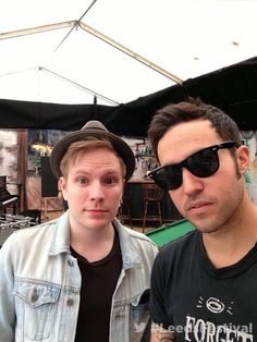 Patrick and Pete under a hut.I'm going to 1 of there concerts on August 5,2014.Its gonna be epic.I'm hopeing he'll sing Rat a tat,Save Rock n Roll,and Young Valcanoes.Cause those are like my total favorite.They're awesome !