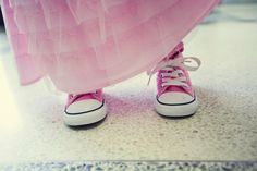 Flower girl in pink Chuck Taylors.