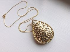 NEW - Metallic Gold and Gold leather pendant that stores Fitbit flex on Etsy, $29.00