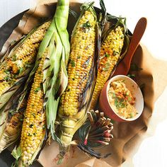 Cilantro and smoked paprika boosts the flavor of this summertime grilled corn. More recipes from the magazine: http://www.bhg.com/recipes/from-better-homes-and-gardens/june-2013-recipes/?socsrc=bhgpin051813limegrillcorn