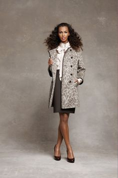 elegant office outfit by ann taylor with a bow blouse, a pencil skirt and a light spring coat