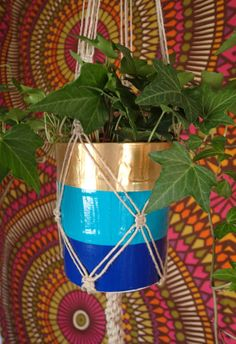 Classic 1970s-style hemp macrame plant hanger with upcycled plastic pot, non-profit shop at https://www.etsy.com/listing/180781868/classic-1970s-style-hemp-macrame-plant