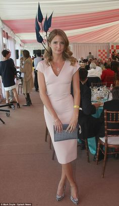 Tickled pink: Millie Mackintosh turned heads when she wore a Victoria Beckham dress and feathered fascinator to the Irish Derby, where she j...
