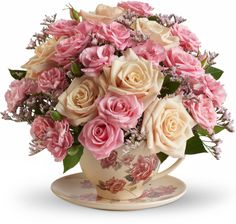 Teleflora's Victorian Teacup Bouquet. Sending these to family members dealing with a loss. <3 Flowers with meaning.