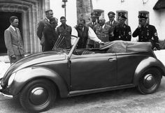 New Toy: Hermann Goering stands next to a KdF Wagen (Volkswagen) convertible at Carinhall hunting lodge, with head of KdF Robert Ley and designer Dr. Ferdinand Porsche on 17 June 1939.