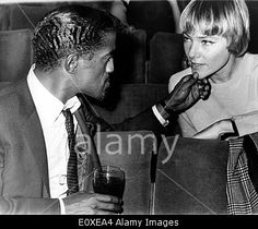 Download this stock image: Sammy Davis Jr. with wife May Britt before appearance on the Royal Variety Show - E0XEA4 from Alamy's library of millions of high resolution stock photos, Stock Photo, illustrations and vectors.