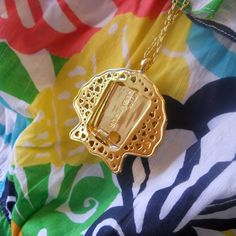 Shell Yeah necklace/bottle opener