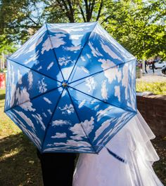 Indianapolis bride and groom shared a love of meteorology so just made sense to incorporate into their photos! Photo by Vow & Forever vowandforever.net