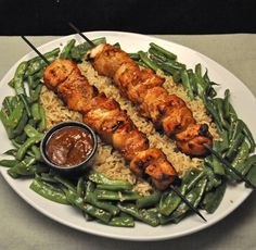 Grilled Chicken Satay with Peanut Sauce on a bed of Sesame Brown Rice and Crisp Green Beans