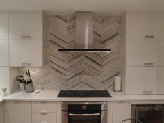 Kitchen Backsplash from Walker Zanger, induction cooktop by Bosch, oven by Bosch