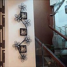 Portaretratos de hierro forjado tallo y flores